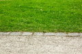 Border between footpath and lawn grass Royalty Free Stock Image