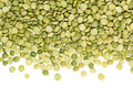 Border of green dry purified peas closeup with copy space on white background. Royalty Free Stock Photo