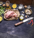 Border Ingredients for cooking concept Turkey meat on a paper for a steak knife grated lemon herbs garlic pepper salt  on rustik w Royalty Free Stock Photo