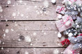 Border from wrapped christmas presents, fur tree branches, red b Royalty Free Stock Photo