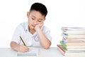 Bored Asian Chinese Little Boy Wearing Student Uniform Writting