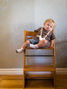 Bored baby in highchair Stock Photography