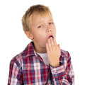 Bored boy young yawning isolated Stock Images