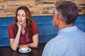 bored couple having coffee together Royalty Free Stock Photo
