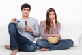 Bored couple watching TV Royalty Free Stock Photography