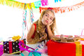 Bored gesture blond kid girl in party with puppy Royalty Free Stock Photo