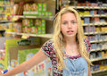 Bored girl in shop blond or grocery store Royalty Free Stock Photo