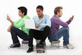 Bored male teenagers sat together Royalty Free Stock Photo