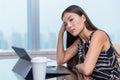 Bored sad tired woman working at boring office job