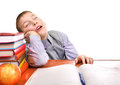 Bored schoolboy is sleeping tired boy on the school desk on the white background Stock Photography