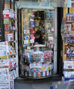 Bored seller waiting customers newspaper stand paris Royalty Free Stock Image