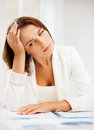 Bored and tired woman with documents business education concept Royalty Free Stock Images
