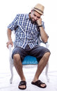 Bored tourist sitting in a chair Royalty Free Stock Photo
