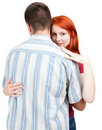 Bored woman hugging by man Stock Photography