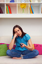 Bored woman watching tv Stock Photo