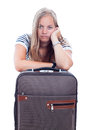 Bored young woman traveling with luggage Stock Photo