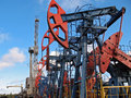 Borehole oil and gas industry work of oil pump jack on a oil field drilling oil well Stock Image