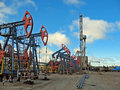 Borehole oil industry and gas industry work of oil pump jack on a oil field drilling oil well Royalty Free Stock Image