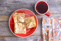 Borek served with a cup of tea view from above three squares fresh homemade turkish made from flaky yufka pastry hot black Stock Photography