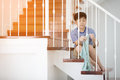 Boring asian child with rag cleaning in the house Royalty Free Stock Photo