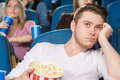 Boring day at the movies Royalty Free Stock Photo