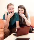 Boring from internet young men and women are Royalty Free Stock Photo