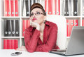 Boring office worker business woman in glasses working at Royalty Free Stock Photography