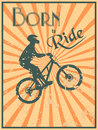 Born to ride vintage style poster with a biker silhouette and text Royalty Free Stock Images