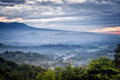 Borobudur temple in the morning mist sunrise over a valley with distance Stock Image