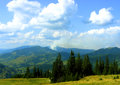 Borsa in maramures mountains romania carphatians mountains sky and trees with green and blue Stock Photos