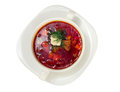 Borsch in white plate isolated on white. Beetroot soup closeup. Royalty Free Stock Photo