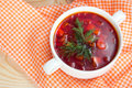 Borsch in white plate isolated on white. Red traditional beetroo Royalty Free Stock Photo