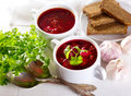 Borscht soup on wooden table Stock Photos