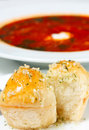 Borscht with sour cream and buns with garlic Royalty Free Stock Photos