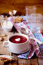 Borscht with sour cream on the wooden background Stock Photography
