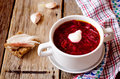 Borscht with sour cream on the wooden background Royalty Free Stock Images