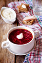 Borscht with sour cream on the wooden background Royalty Free Stock Photos
