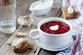 Borscht with sour cream on the wooden background Royalty Free Stock Photo