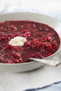 Borscht vertical bowl of homemade soup with spoon and dollop of cream Stock Photography