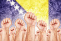 Bosnia and herzegovina labour movement workers union strike concept with male fists raised in the air fighting for their rights Royalty Free Stock Photos