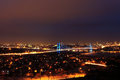 The bosphorus bridge in blue lights a night view of istanbul turkey and Stock Photography
