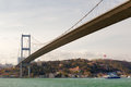Bosphorus bridge istanbul turkey view to from the strait with floating boat Royalty Free Stock Photo