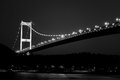 Bosphorus bridge at night horizontal and dark photo of and fatih sultan mehmet of istanbul turkey with lights Royalty Free Stock Photos