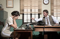 Boss arguing with young secretary in the office furious director s vintage Stock Photo