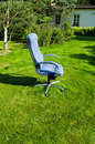 Boss chief office chair in garden lawn grass cut Royalty Free Stock Photos