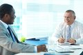 Boss and employee portrait of senior his laughing at meeting Royalty Free Stock Photos