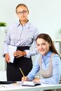 Boss and employee vertical shot of a female her pretty Stock Image