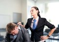 Boss girl pulls a men by the collar suit Stock Images