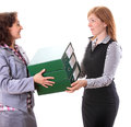 Boss give away work for her assistant Royalty Free Stock Photo