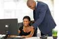 Boss guiding employee friendly african his new with her work Stock Images